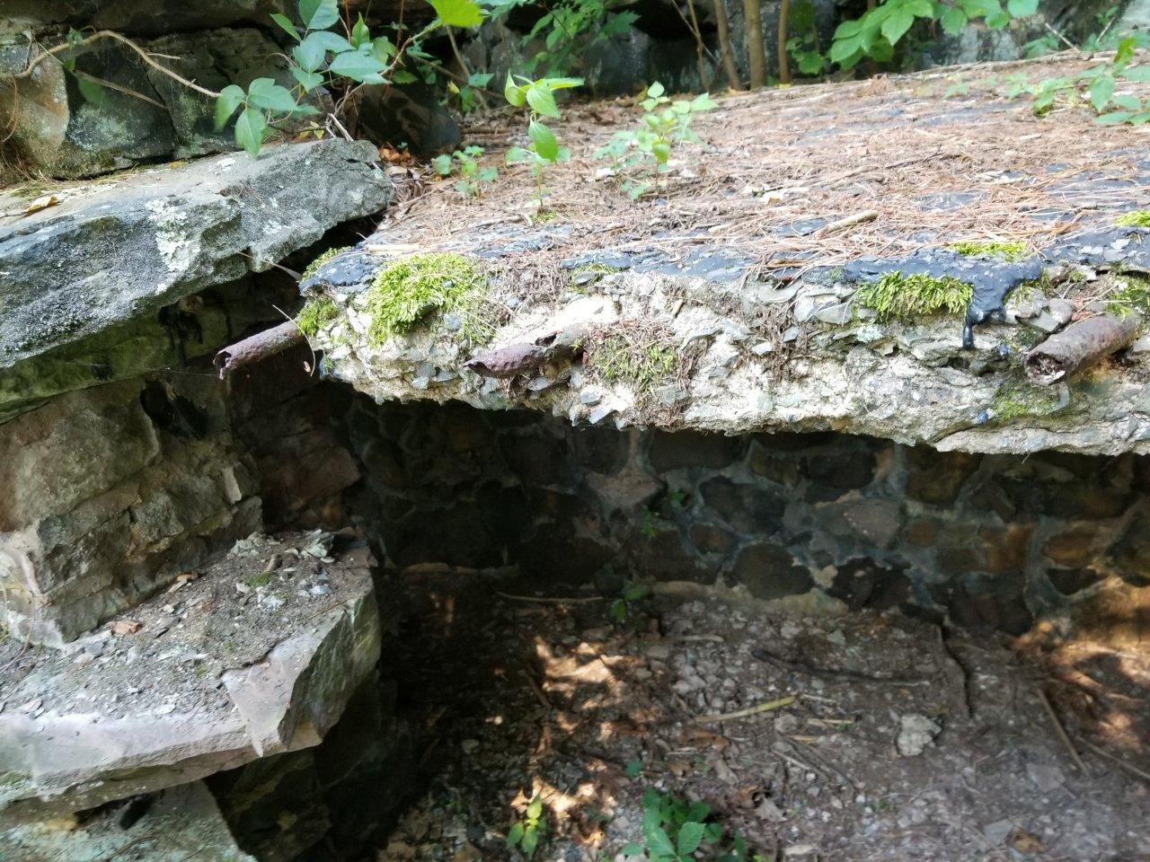 The HofHeimer Grotto, Closeup of broken slab and railing support