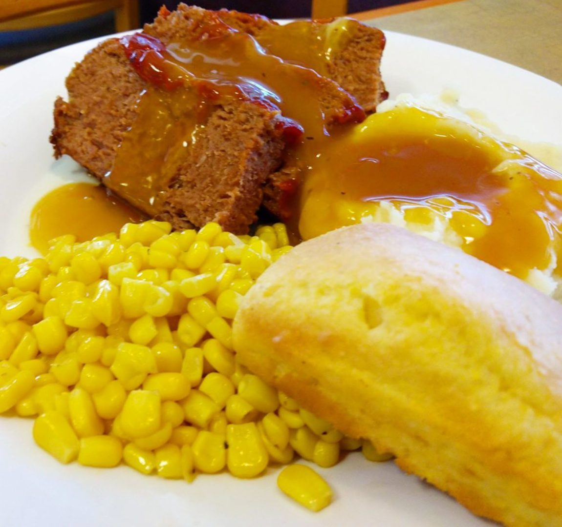 Meatloaf, mashed potatoes, corn and biscuits